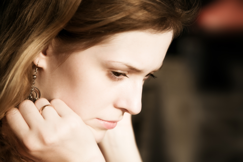 Thoughtful and sad woman portrait.